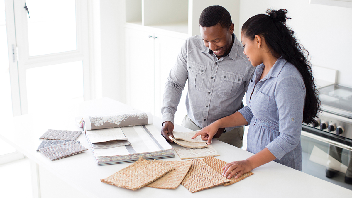 couple looking at renovation samples